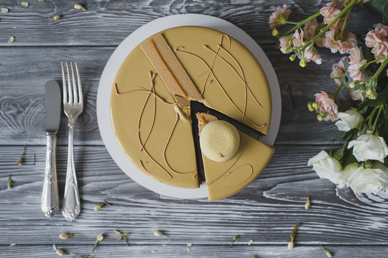 bakery-with-piece-of-unusual-yellow-mousse-cake-LQH3B78